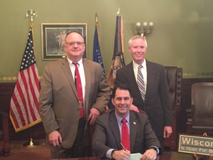 Governor Walker signs AB 568